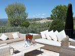 Aperitifs on the terrace overlooking perched medieval village and castle of Callian