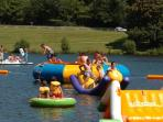 Inflatables and floats in the water at Lac de Vassiviere.