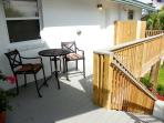 The front deck is welcoming and also has an outdoor shower.