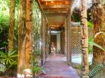 Covered walkways featuring hand-carved totems exude authentic Salvadorian vibrations throughout