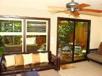 Downstairs Living Room, entrance and Lanai outside.