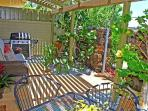 Downstairs Lanai with BBQ, sitting area and Dining Table.