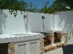 outdoor barbecue area with  refrigerator