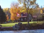 The Lake House in the fall from the lake.