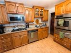 Kitchen has dishwasher, tile counter tops with lots of cabinet space