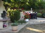 BBQ and summer dining area by the pool and garden at the back of the cottage