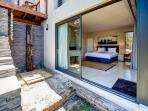 bedroom with kingsize bed and outside shower