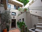 First Courtyard with stairs leading to master and roof patio