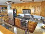The updated kitchen has new stainless appliances, granite counters -- and two dishwashers.