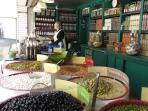 St Pierre market's popular olive seller also has delicious tapenades and welcomes tastings