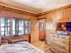 Master Suite C upstairs with king bed, HDTV and views of the lake.