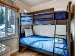Upstairs Suite C half bedroom. Twin bunks share with washer/dryer. Opens to mater bedroom.