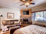 Downstairs Suite B with queen size bed, fireplace, HDTV, sofa and views of the lake