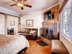 Downstairs Suite B with queen size bed, fireplace, HDTV, and sofa