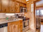 Suite C full kitchen, fully stocked, granite counters, new cabinets, dishwasher.