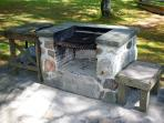 The barbeque with adjustable grill. Firewood supplied