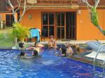 Guests enjoying the pool