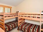 Third bedroom with two twin bunk beds located on upper level