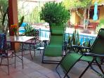 The Bougainvillea's patio with reclining loungers, table and chairs. Next 8 photos of this unit.