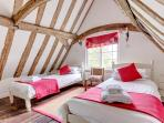 …vaulted twin bedroom with original oak floor.
