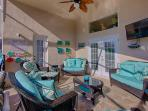 42 inch HDTV and padded rattan patio set