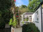 Alma Cottage is set in a private secluded garden.