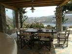 BY THE SWIMMING POOL COMMUNAL AREA OVERLOOKING THE BAY OF ORNOS AND THE CHORA