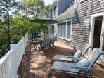 The expansive deck offer plenty of seating including 2 lounge chairs - 151 Sky Way Chatham Cape Cod New England...