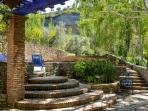 Beautiful terraces and steps leading to the surrounding countryside and alberca (water cistern).