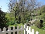 Slad cottage rental - view from garden of streams