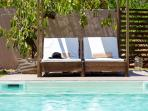 Shaded sunbeds next to the 38sqm pool!