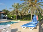 Spacious patios around the pool & house