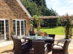 Outdoor dining area. Open up the folding doors to expand the kitchen area and enjoy a BBQ