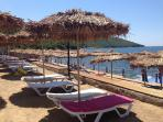 Beach with sunbeds and umbrellas - all free - 125m away.