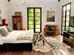 Masterbedroom overlooking onto private pool in one side and paddy field at the other side