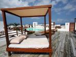 Common Casa del Mar rooftop pool area with large beds