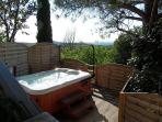 Hot tub for 6 over looking views in a secluded raised area of garden