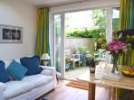 French doors leading onto a private decking area in the garden