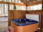 The 5-person hot tub is enclosed in a private cabana.