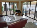 Living room with view to the swimming pool