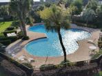The fabulous pool by day, view from balcony. There is a shallow end for the small ones.