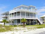 This beautiful home is steps away from the beach and offers lots of deck space and private pool.