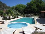View across jacuzzi and pool from sun bathing terrace