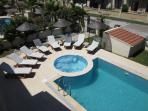 View of jacuzzi and sun bathing terrace from balcony