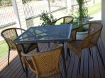 Enjoy outdoor dining on your very own deck.