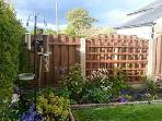 Small enclosed garden with seating area