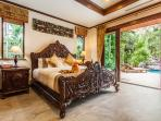 Luxury at it's finest. King size Master bedroom with hand carved custom teak furniture.  Opens up to