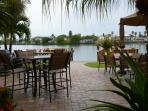 Patio View to Boca Ceiga Bay and docks for fishing or boating. Rentals nearby.