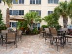 Patio with ample seating, grills, pool and view of Boca Ceiga Bay