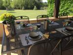 Large terrace and extensive dining area, views over 2 acre garden. All sizes of wine glasses